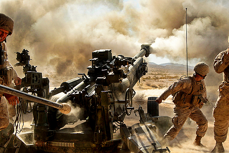 military photos exercising the howitzer